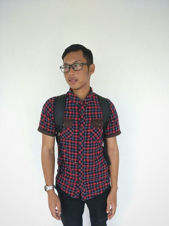 One Man Only Only Men Adults Only One Person Eyeglasses  Button Down Shirt Three Quarter Length Adult Checked Pattern People Black Hair Front View One Young Man Only Casual Clothing Standing Young Adult Indoors  The Portraitist - 2017 EyeEm Awards The Portraitist - 2017 EyeEm Awards EyeEmNewHere EyeEm Selects