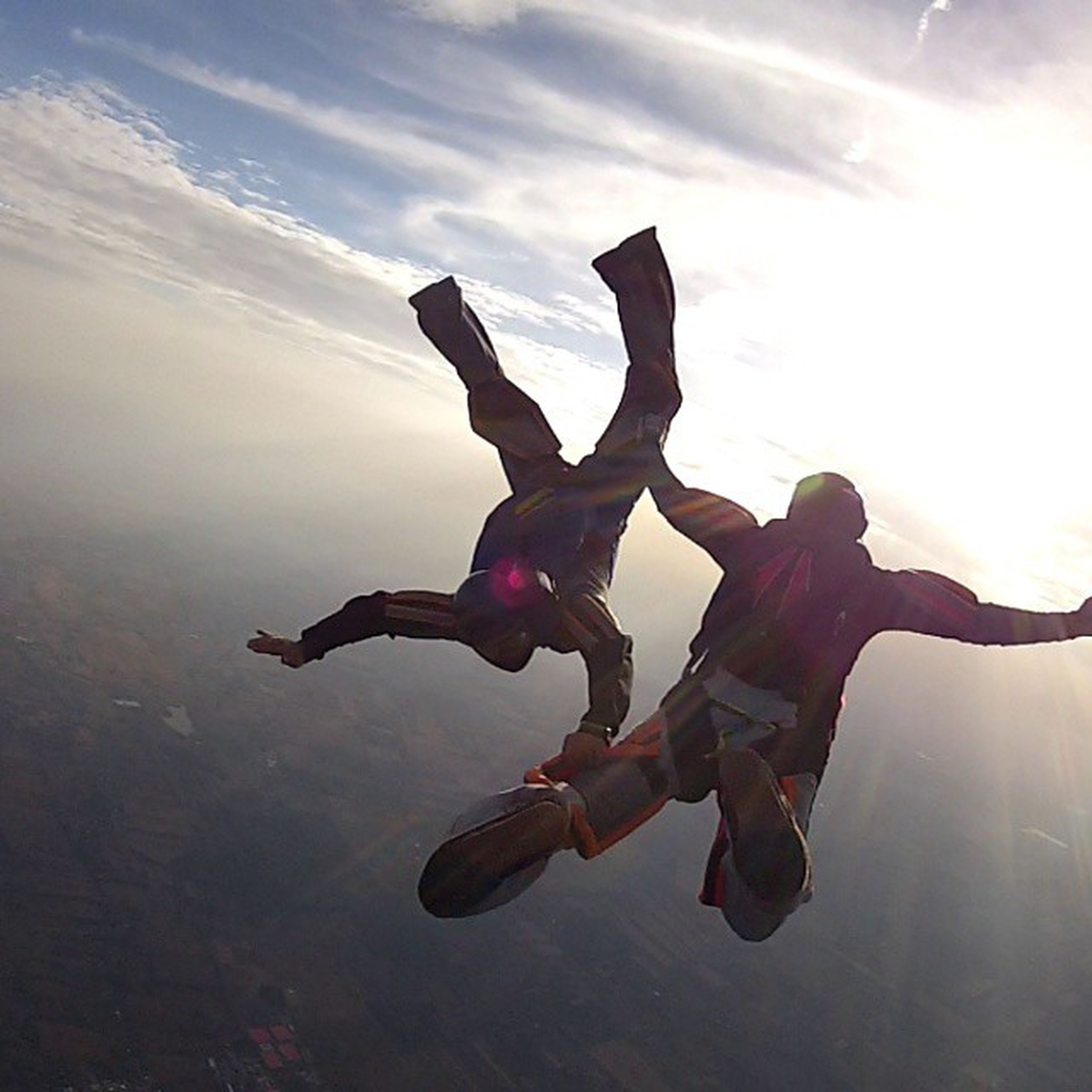 lifestyles, leisure activity, mid-air, full length, jumping, fun, arms outstretched, enjoyment, arms raised, skill, men, sky, carefree, holding, motion, low angle view, balance, vitality