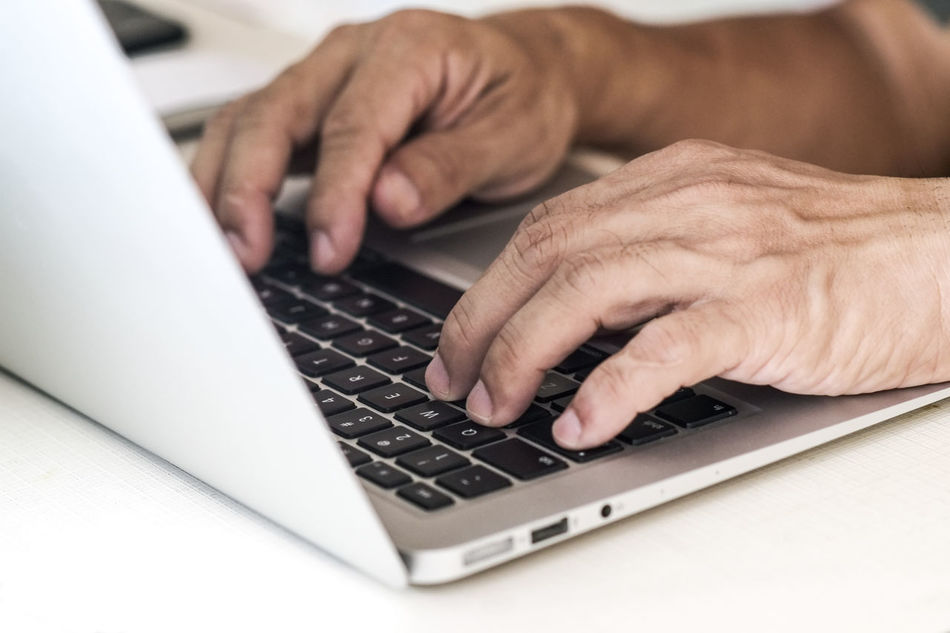 Closeup of fingers typing on laptop keyboard Closeup Communication Computer Connection Fingers Hands Horizontal Keyboard Laptop Natural Light People Technology Typing Using Laptop Working