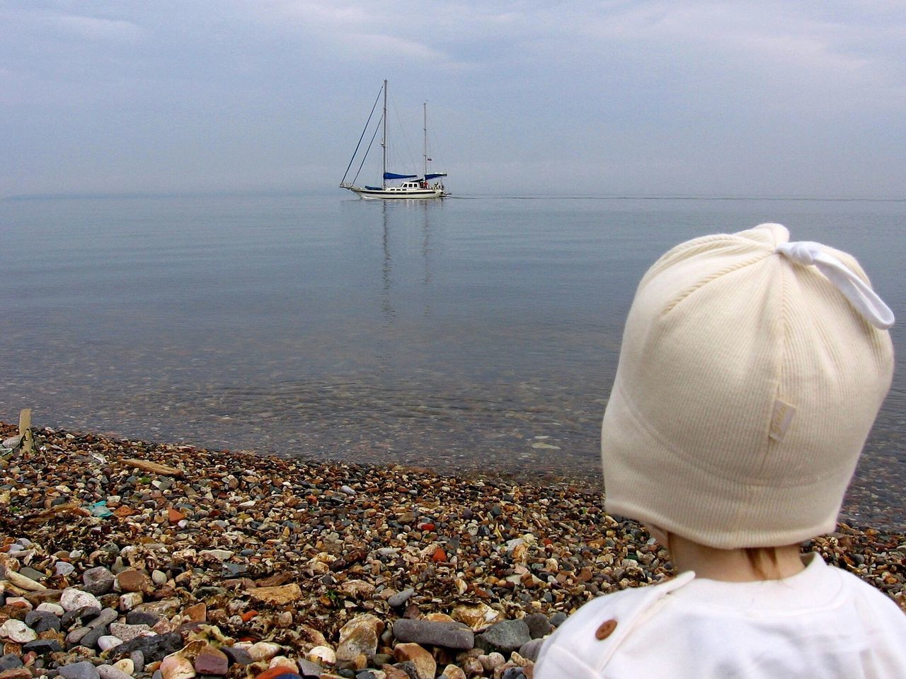 Enchanted baby at the seaside Feel The Journey Beach Stones Seascape Calm Sailer Charm Dream People Of The Oceans
