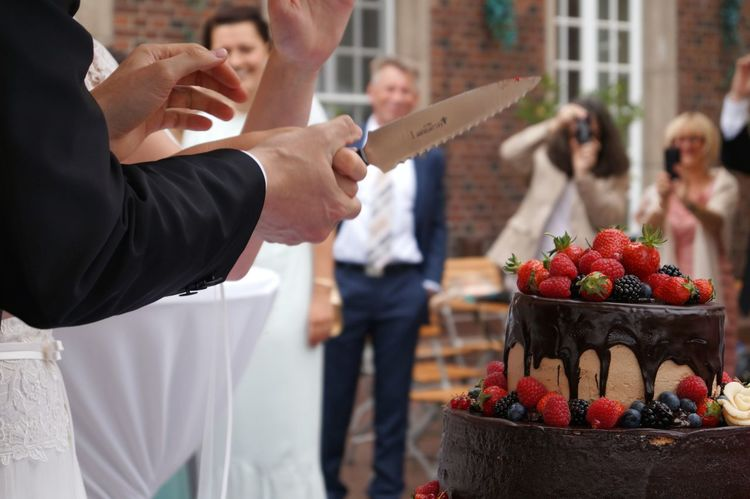 "The ""fight"" who will have the hand above the other hand... will be the boss... Cropped Female Male Hands Holding Knife Wedding Cake Chocolate Cakes Groom Bride Happy Day Macro Photography Cropped People Cutting Cake Suit Strawberries Coffee Time Sweet Food Coffee Guests People In The Background German Tradition Berries The Photojournalist - 2016 EyeEm Awards EndlessLove Summer Wedding"