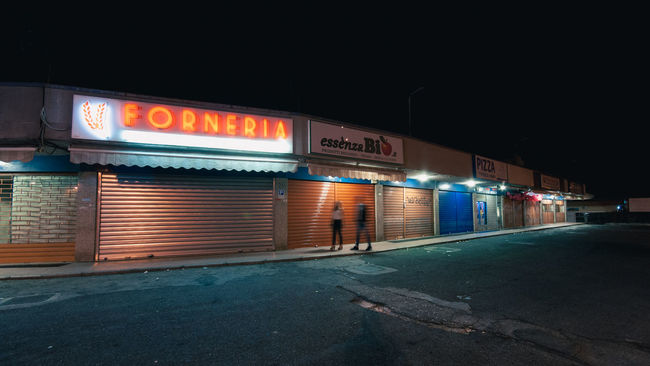 Architecture Asphalt Building Exterior Built Structure City City Life Colors Couple Ghosts Illuminated Long Exposure Neon Night Night Lights Nightlife Nightphotography Orange People Road Store Street Street Photography Streetphotography Walk Walking