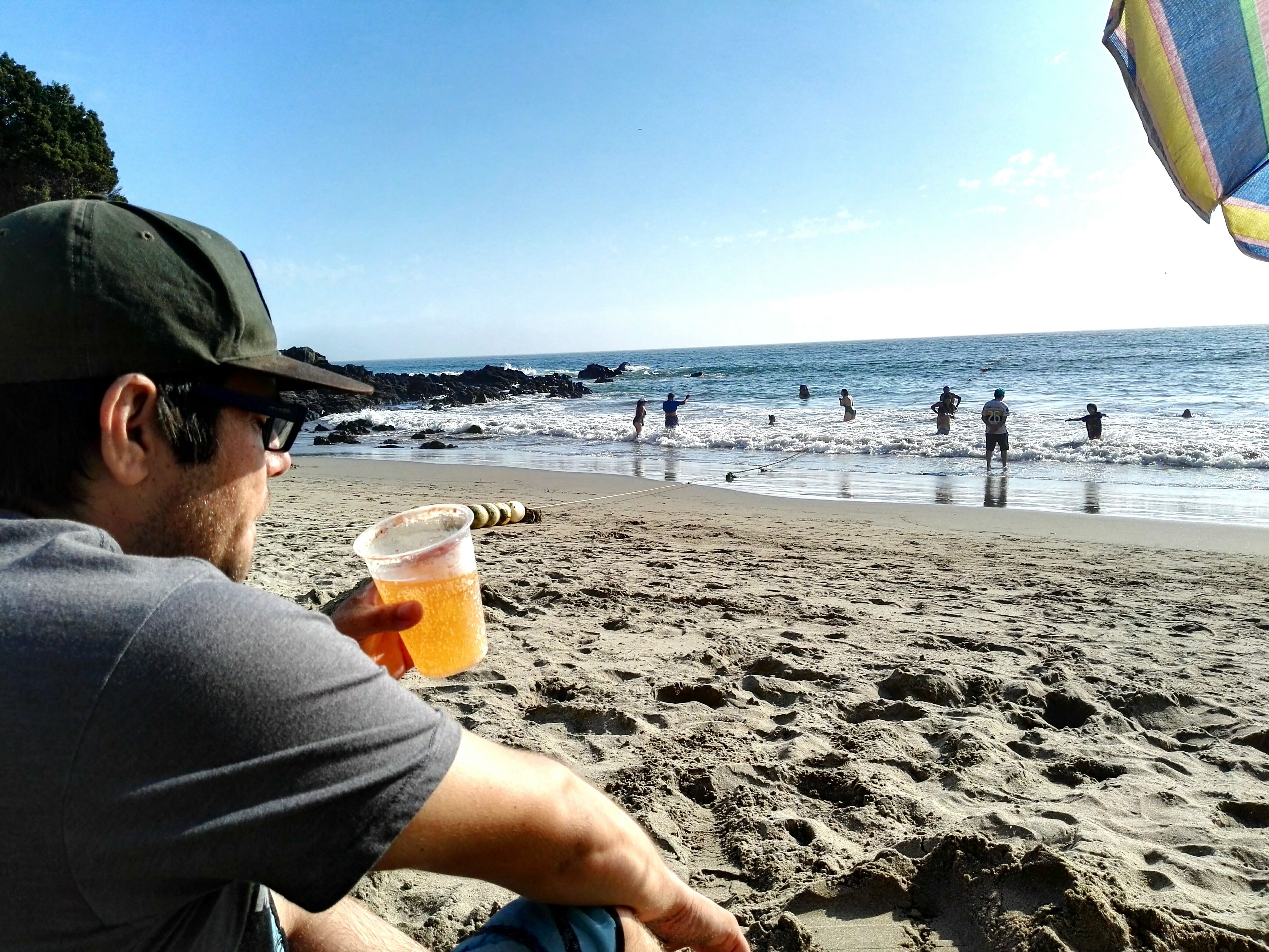 sea, beach, water, sky, clear sky, sand, real people, day, outdoors, lifestyles, men, nature, vacations, drink, horizon over water, close-up, people, adult