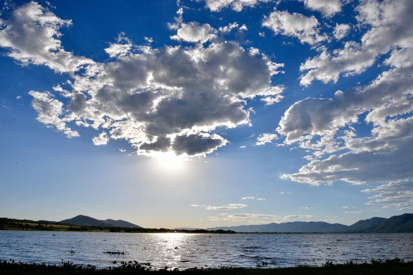 Sunshine day South Africa South Africa Is Amazing Meerhofskool Southafrica Meerhof Hartebeespoort Hartbeespoort Dam Hartbeespoort Dam Wall Sky Beauty In Nature Cloud - Sky Scenics Tranquility Nature Sunlight Tranquil Scene Sea Outdoors Water No People Day Blue Mountain