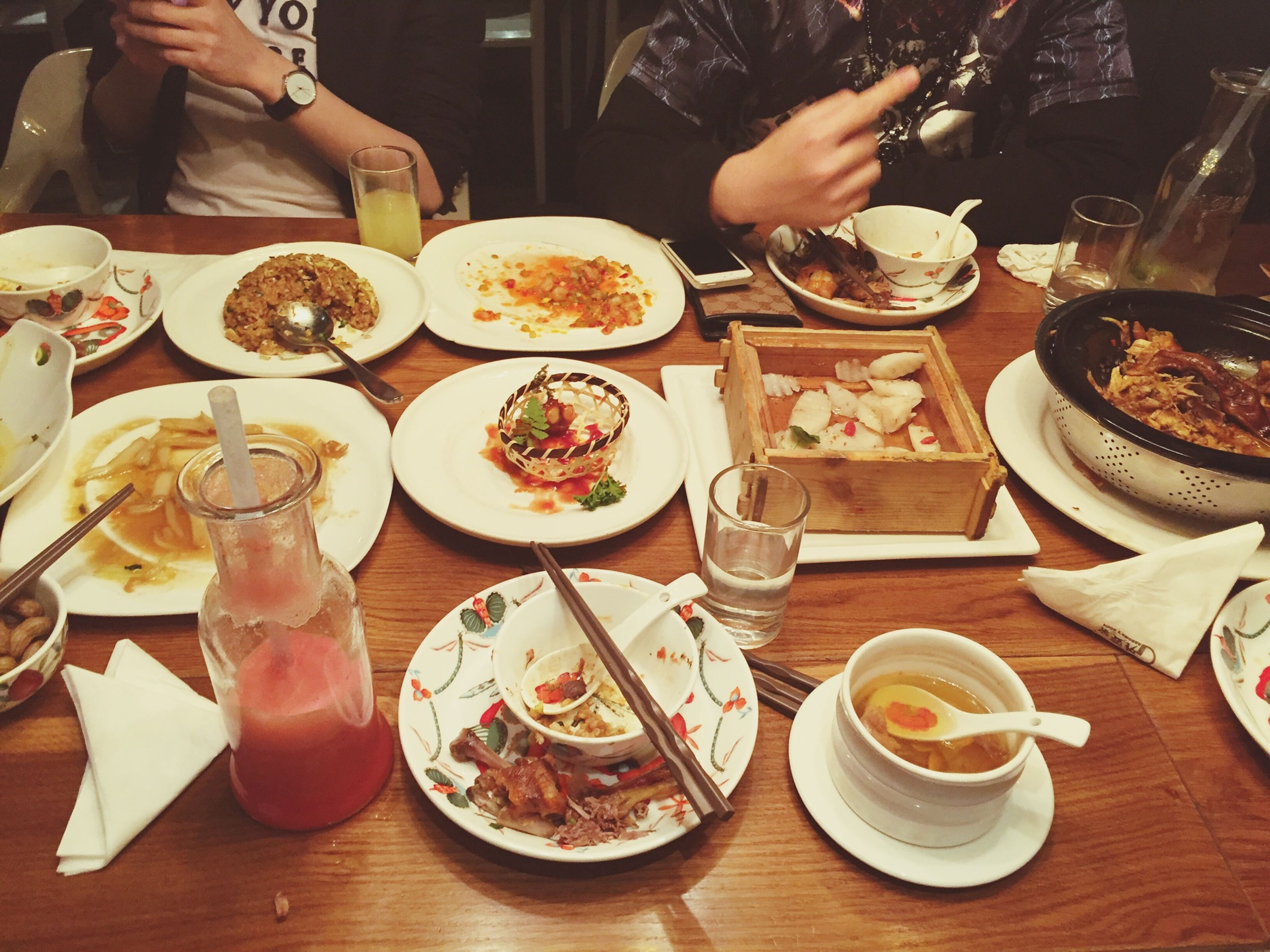 food and drink, food, freshness, table, indoors, ready-to-eat, healthy eating, plate, person, drink, meal, bowl, restaurant, meat, serving size, high angle view, incidental people, lifestyles