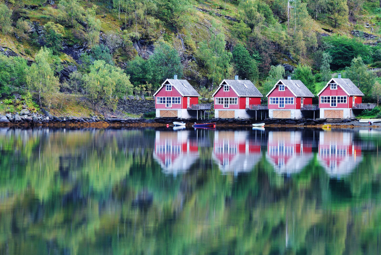 Boat house in Flam, Norway. Architecture Aurlandsfjord Boat House Built Structure Cruise Fjord Flåm Geirangerfjord Geirangerfjorden Gudvangen House Hut Idyllic Landscape Lysefjord No People Norway Outdoors Red Reflection Sogn Og Fjordane Sognefjord Travel Destinations Viking Water