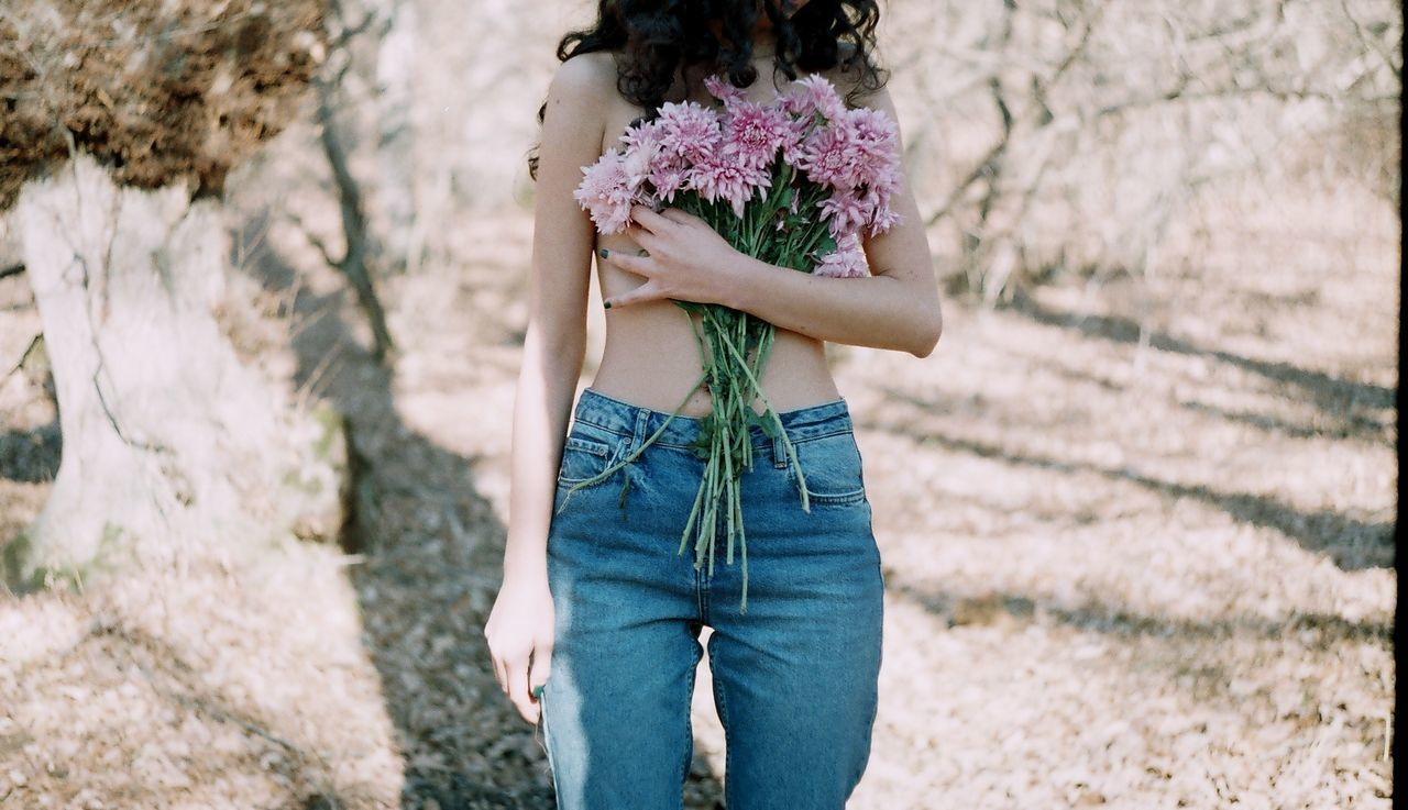 35mm film Adult Adults Only analog Analogue Photography day EyeEmNewHere Film film photography flower flowers forest human body part human hand Nature nüde Art. one person only women outdoors people teenager