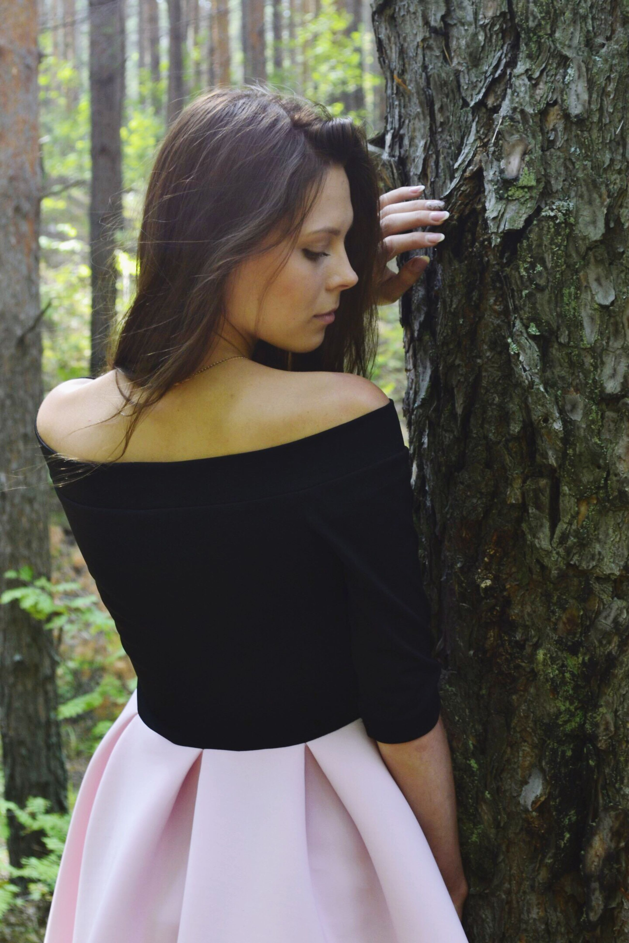 young adult, person, young women, lifestyles, casual clothing, leisure activity, long hair, front view, portrait, looking away, focus on foreground, contemplation, black hair, beauty, outdoors, sensuality, day