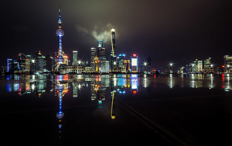 the view / Architecture City City At Night Cityscape Cityscape Colors EyeEm Best Shots Igniting Illuminated Long Exposure Mirrored Night Night Lights No People Oriental Pearl Tower Puddleography Reflection Shanghai Skyline Skyscraper Tower Travel Destinations Urban Skyline View Water