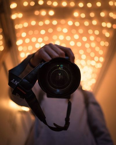 Photographing Camera - Photographic Equipment Illuminated Focus On Foreground Holding Technology Real People One Person Digital Camera Photography Themes Indoors  Camera Photographer Men Digital Single-lens Reflex Camera Night Close-up People
