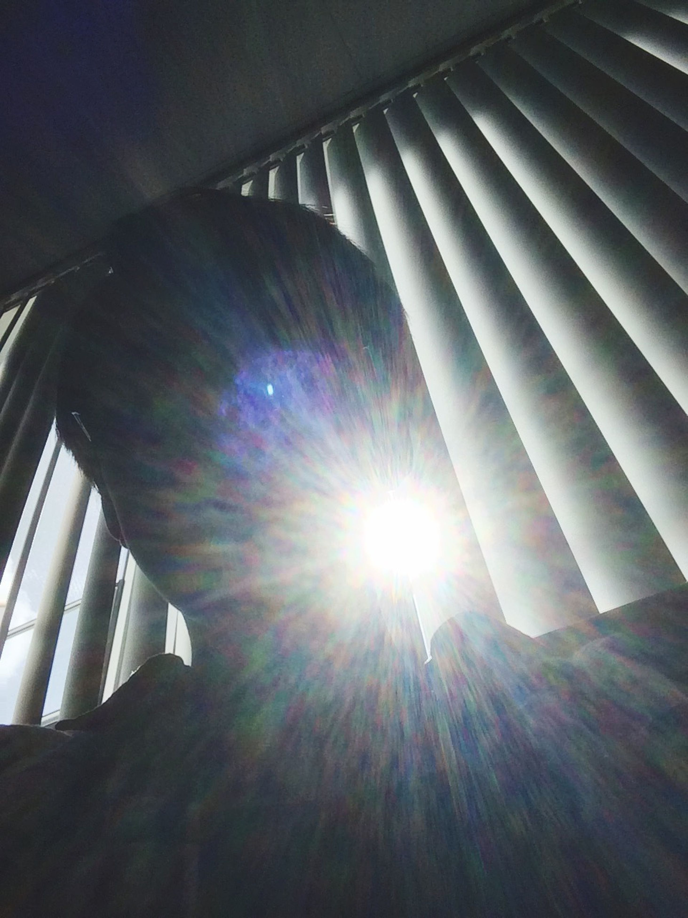 low angle view, built structure, sunbeam, sun, architecture, sunlight, lens flare, modern, indoors, building exterior, building, day, sky, skyscraper, sunny, glass - material, no people, reflection, bright, office building
