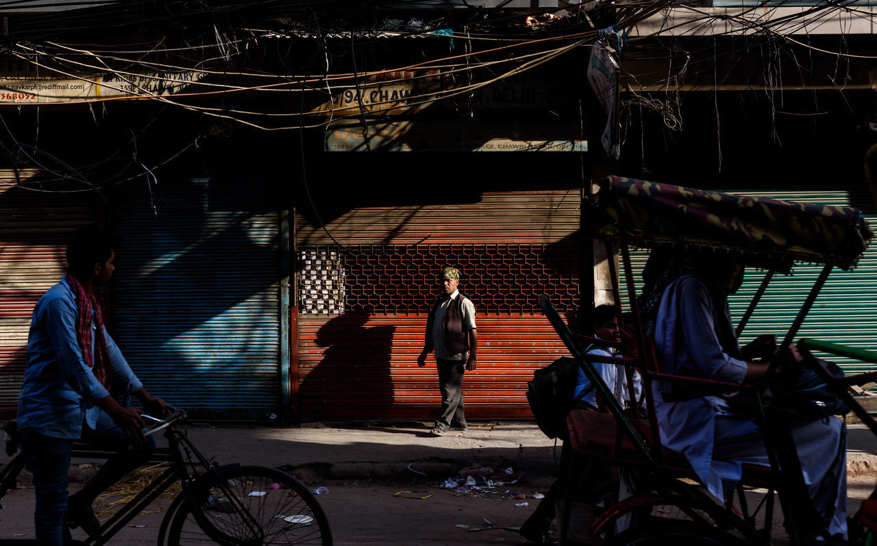 EyeEmNewHere New Delhi, India travel destinations streetphotography india travel traffic flow chandnichowk craziness EyeEm Best Shots old delhi Shutters rikshaw street photography Shadows & lights Morning Light intense colors one person