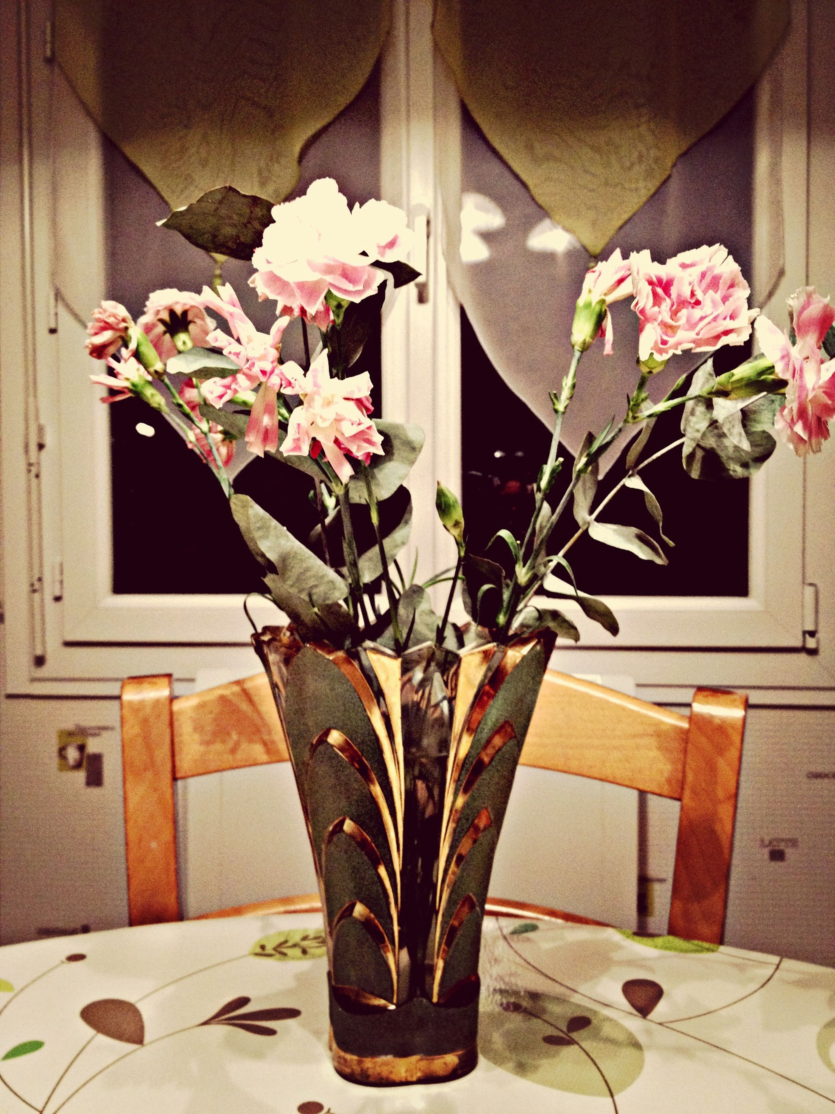 flower, indoors, potted plant, table, home interior, vase, high angle view, fragility, house, plant, freshness, wood - material, petal, growth, chair, no people, flower pot, leaf, bouquet, wall - building feature