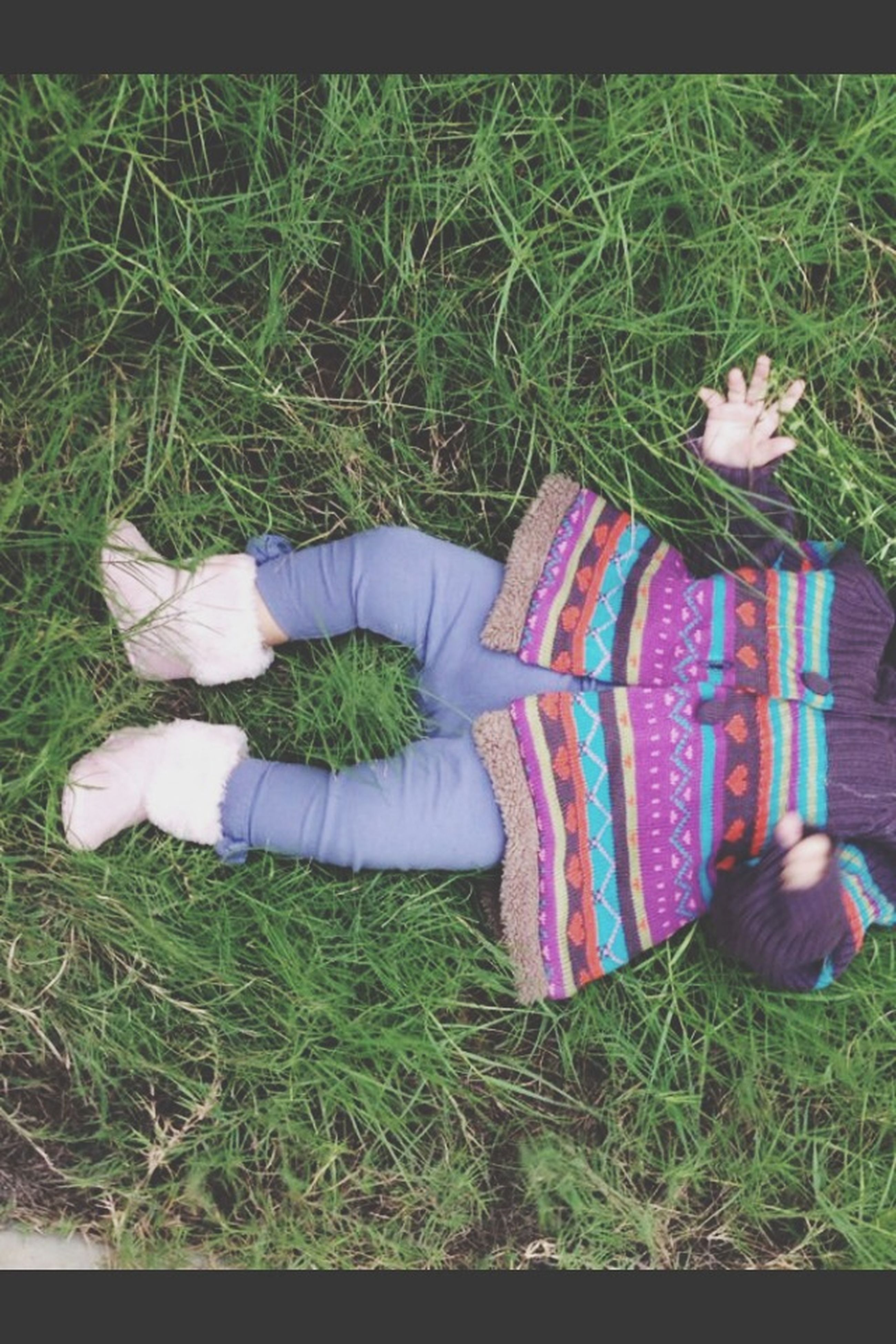 grass, grassy, low section, field, relaxation, high angle view, person, lying down, shoe, childhood, resting, sitting, footwear, green color, day, relaxing, outdoors, leisure activity