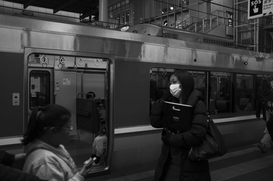 Casual Clothing Commuter Train Day Indoors  Lifestyles Metro Train Mode Of Transport Passenger Train People Public Transportation Rail Transportation Real People Sitting Standing Subway Train Train - Vehicle Transportation Two People Vehicle Seat Women Young Adult Young Women
