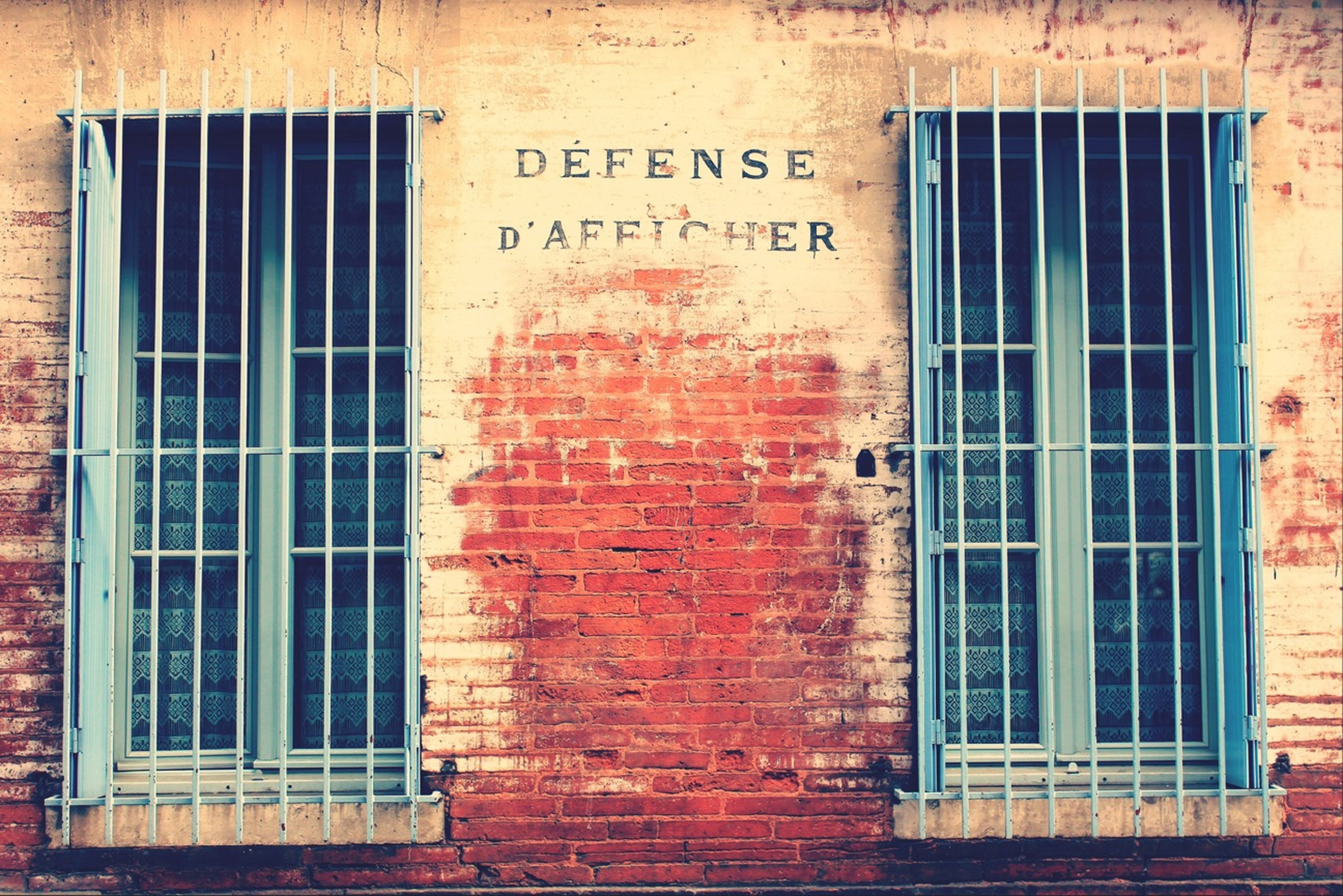 architecture, building exterior, built structure, window, closed, brick wall, door, wall - building feature, house, old, wall, weathered, residential structure, safety, text, building, day, outdoors, residential building, protection