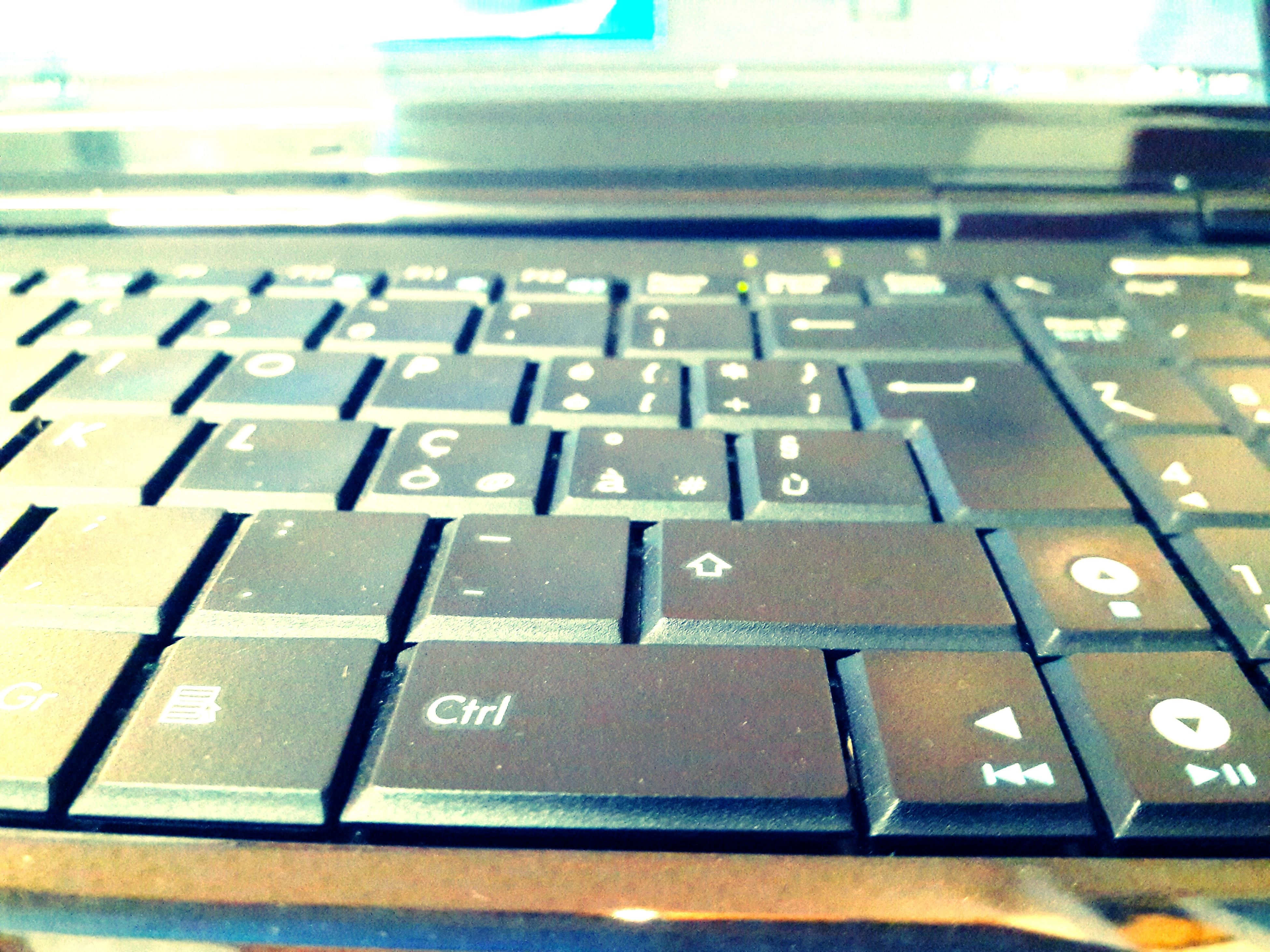 indoors, communication, text, number, western script, close-up, technology, capital letter, computer keyboard, selective focus, focus on foreground, connection, no people, alphabet, wireless technology, laptop, control, pattern, blue, high angle view