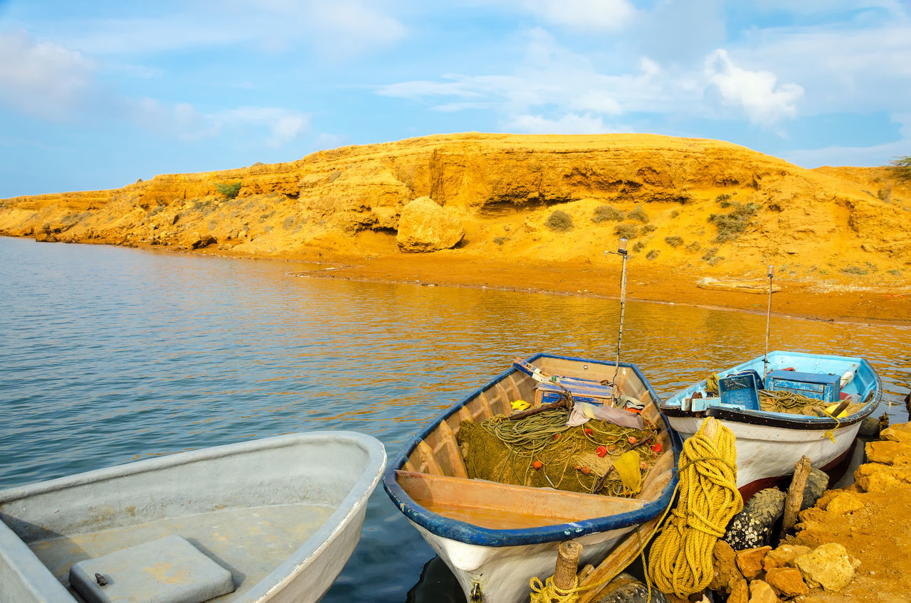 Three boats in Punta Gallinas in La Guajira, Colombia Bay Boat Boats Coast Colombia Color Horizon Idyllic La Guajira La Guajira Colombia Landscape Nature Nature Ocean Outdoor Outdoors Punta Gallinas Sand Sea Sunrise Tourism Transportation Travel Vacation Water