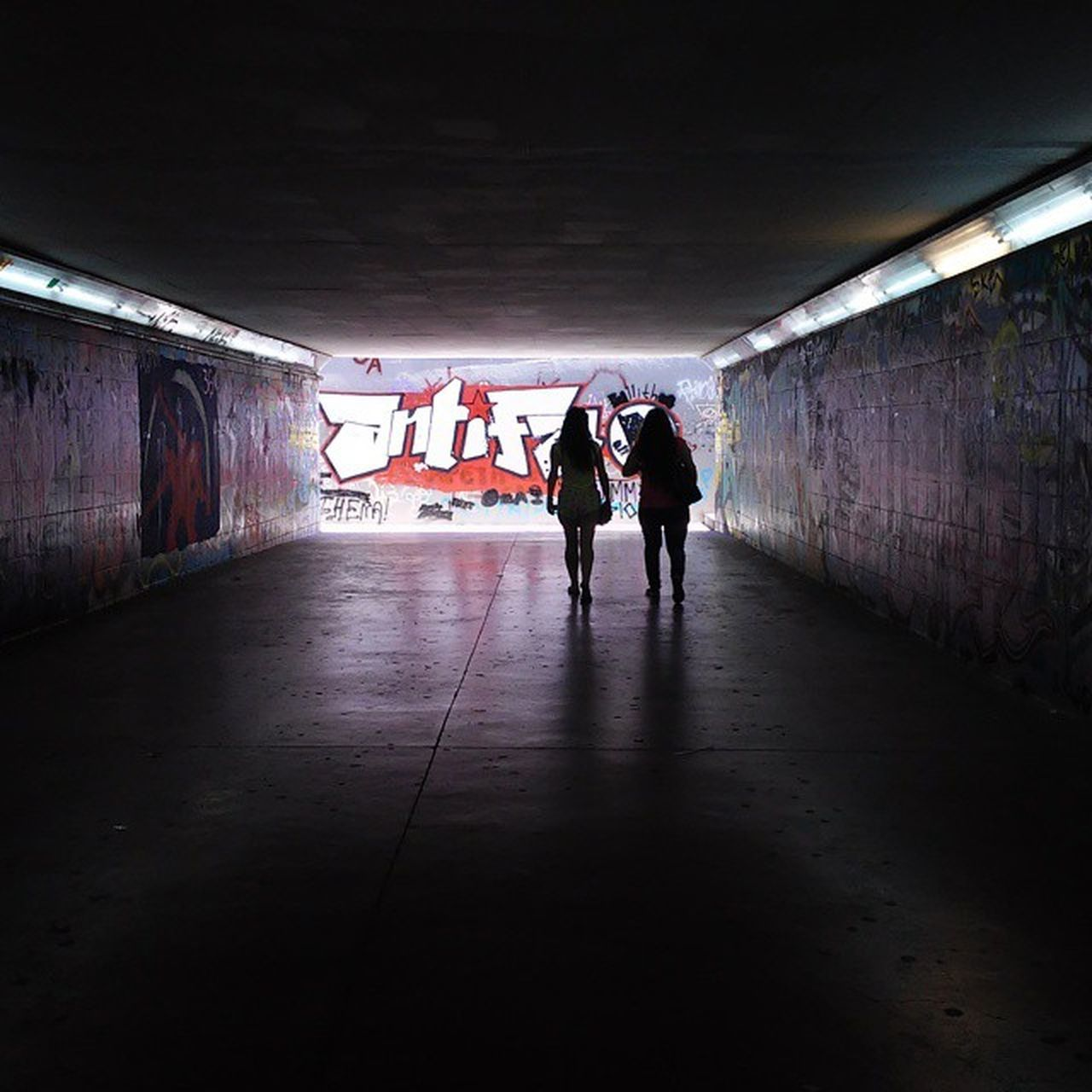 Underneath the bridge The tarp has sprung a leak.. Underground Girls Passingthrough  Grafity Shadows Light Darkness Nofilter ¤