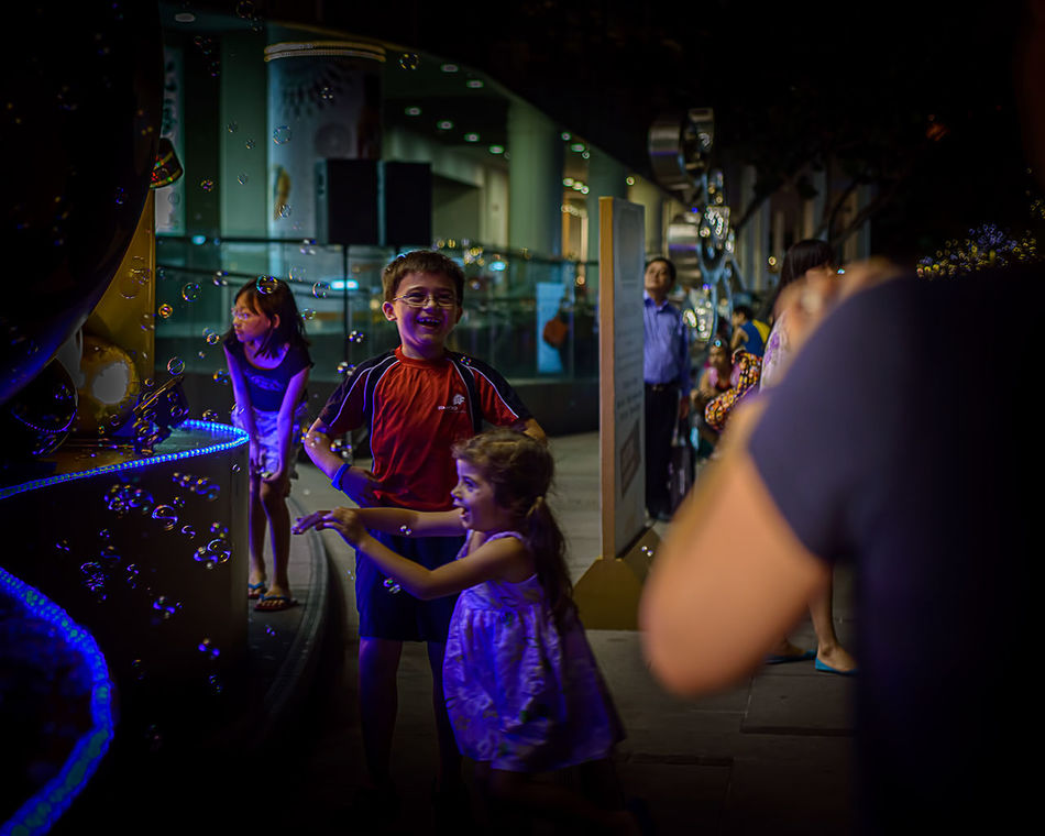 Kids In Christmas © Chit Min Maung http://www.cmmaung.me/ Arts Culture And Entertainment Best Christmas Lights C Cmmaung.me Kids Playing Soap Bubbles Street Streetphoto_color Streetphotography