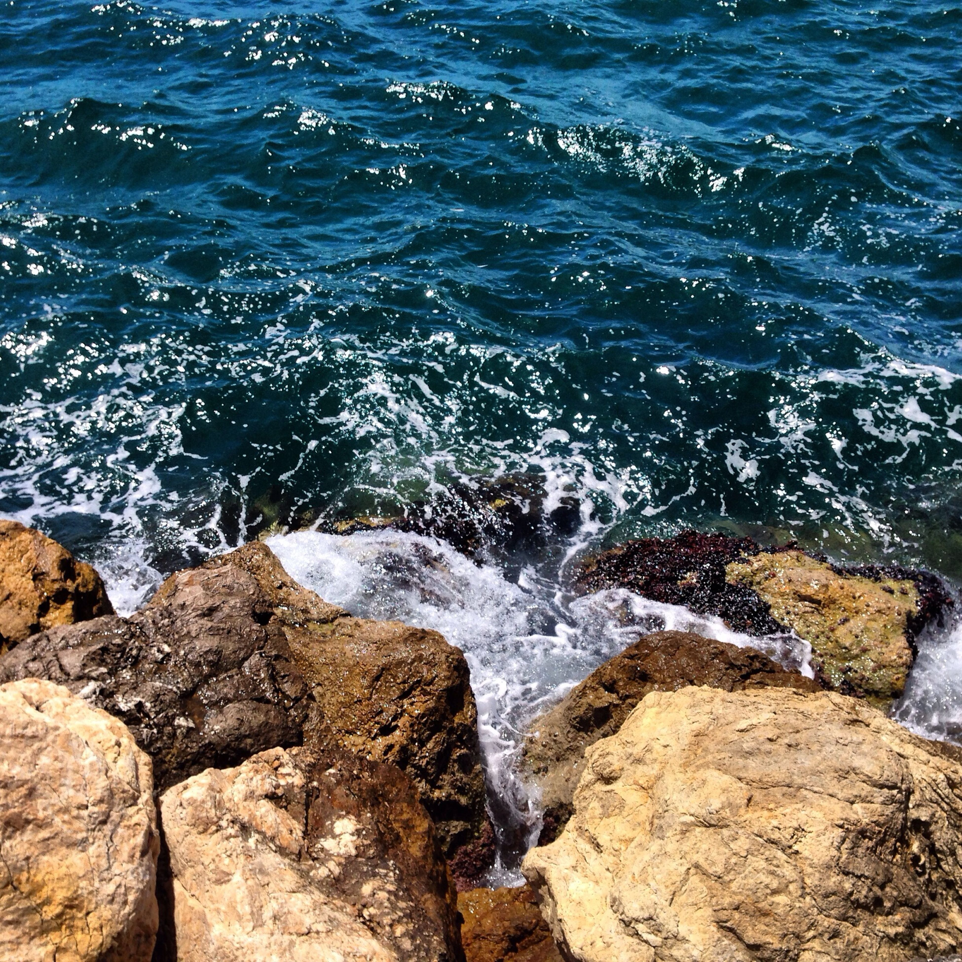 water, surf, sea, wave, motion, splashing, rock - object, beauty in nature, nature, scenics, high angle view, power in nature, rock formation, rock, shore, day, idyllic, outdoors, flowing water, no people