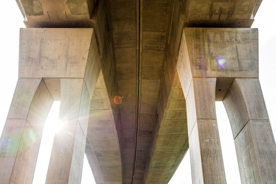 Architectural Column Architecture Architecture Architecture_collection Below Bridge - Man Made Structure Built Structure Concrete Connection Day Low Angle View No People Outdoors Strength Structure Sun Sunlight Sunlight Transportation Under Underneath The Secret Spaces