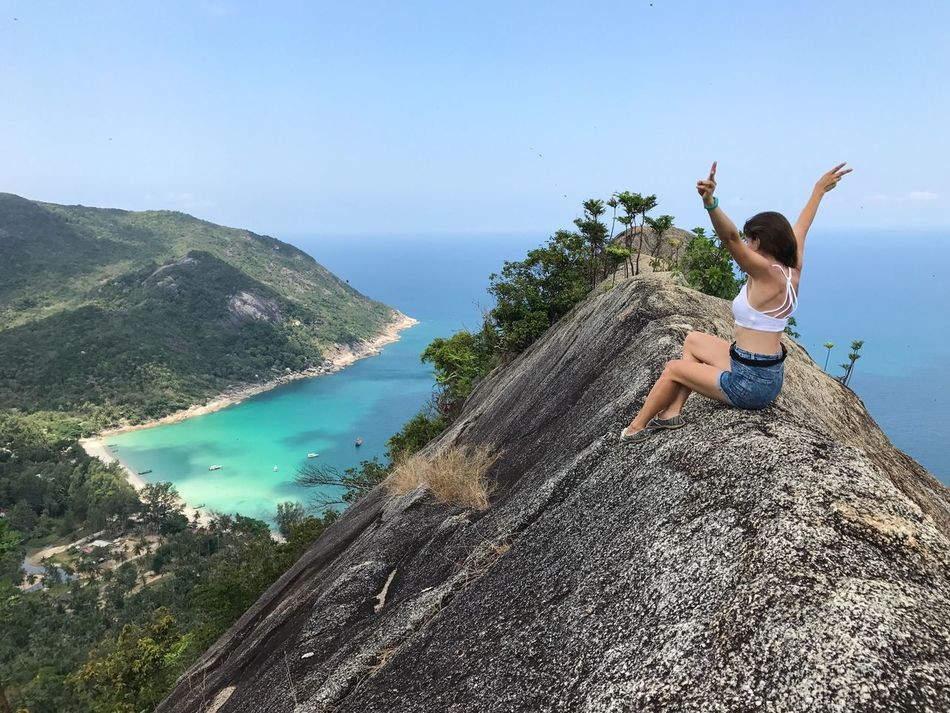 Adventure Beauty In Nature Day Enjoying The View Full Length Happiness Healthy Lifestyle Hiking Leisure Activity Mountain Nature One Person One Woman Only Outdoors Relaxation Rock Formation Sea Top Of The Rock Tourism Travel Destination Vacations View From The Top Water Women Around The World Young Women
