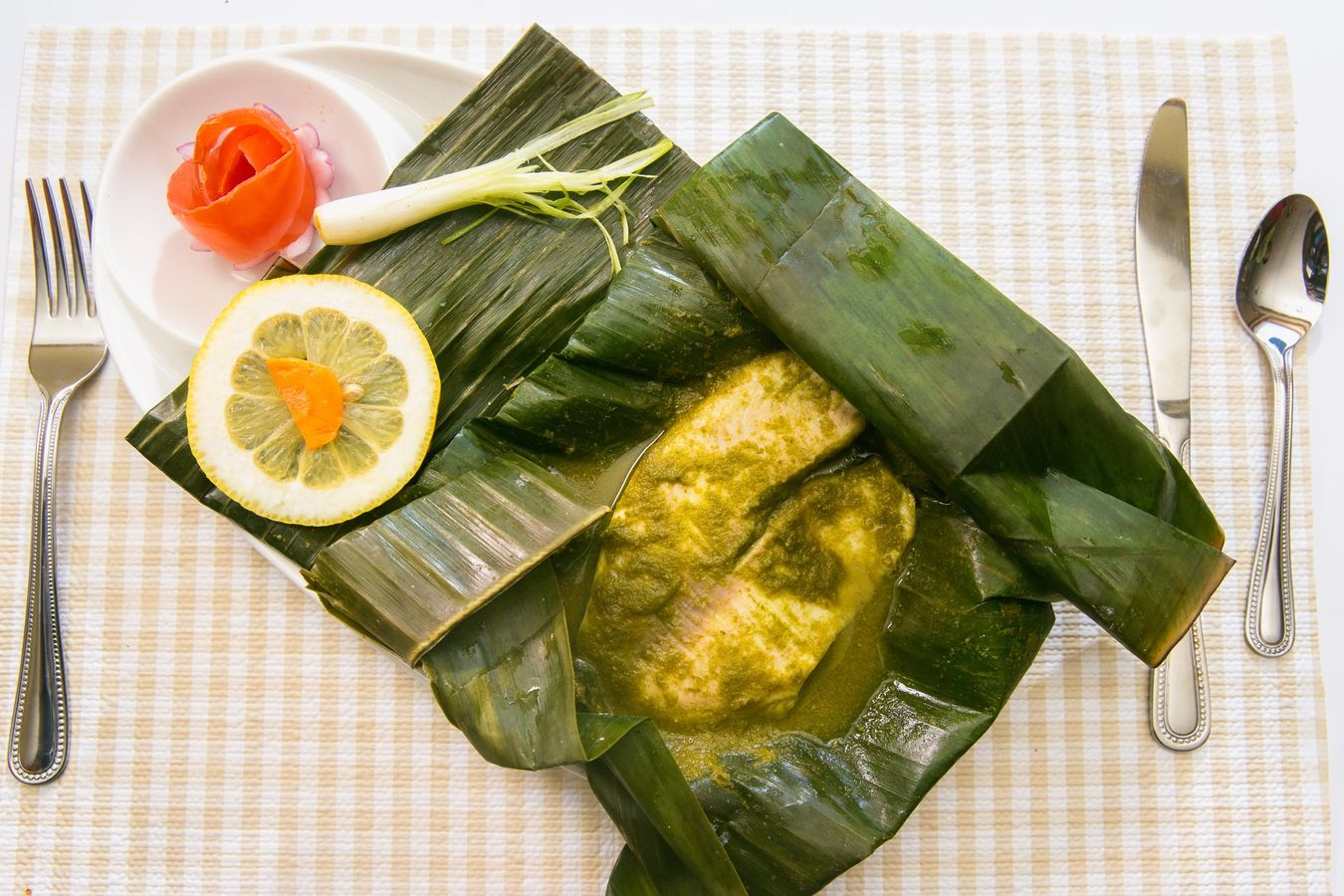 Food Porn Awards Patrani machchi (steamed fish) from the popular Parsi cuisine , Patrani machchi is cooked by marinating the fish fillets in the green sauce made of mint, coconut and other spices . The marinated fish is wrapped with a banana leaf and steam cooked .. Parsi Foodie Fish Food Porn