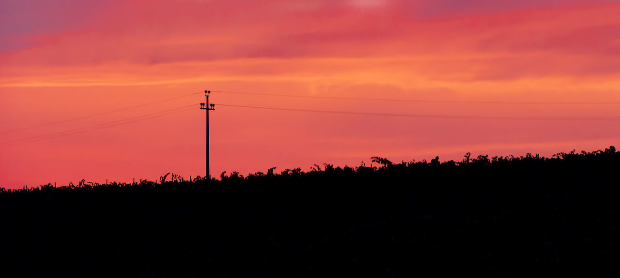 sunset, silhouette, connection, cable, nature, beauty in nature, orange color, sky, technology, scenics, electricity, power supply, power line, tranquil scene, no people, landscape, tranquility, electricity pylon, tree, fuel and power generation, outdoors, low angle view, telephone line, day