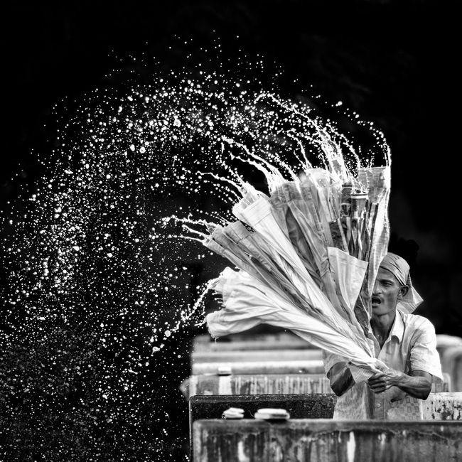 Capture The Moment A dhobi washing clothes. Dhobi Washing Clothes Backlight Water Sprinkle Chennai Monochrome Photography