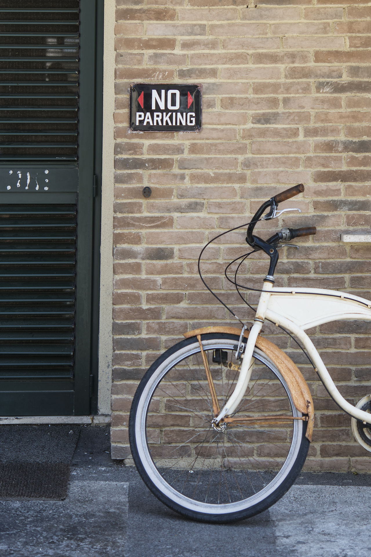 Architecture Bicycle Bike Parking Brick Wall Building Exterior City Day Mode Of Transport No Parking Sign No People Old Fashioned Outdoors Transportation