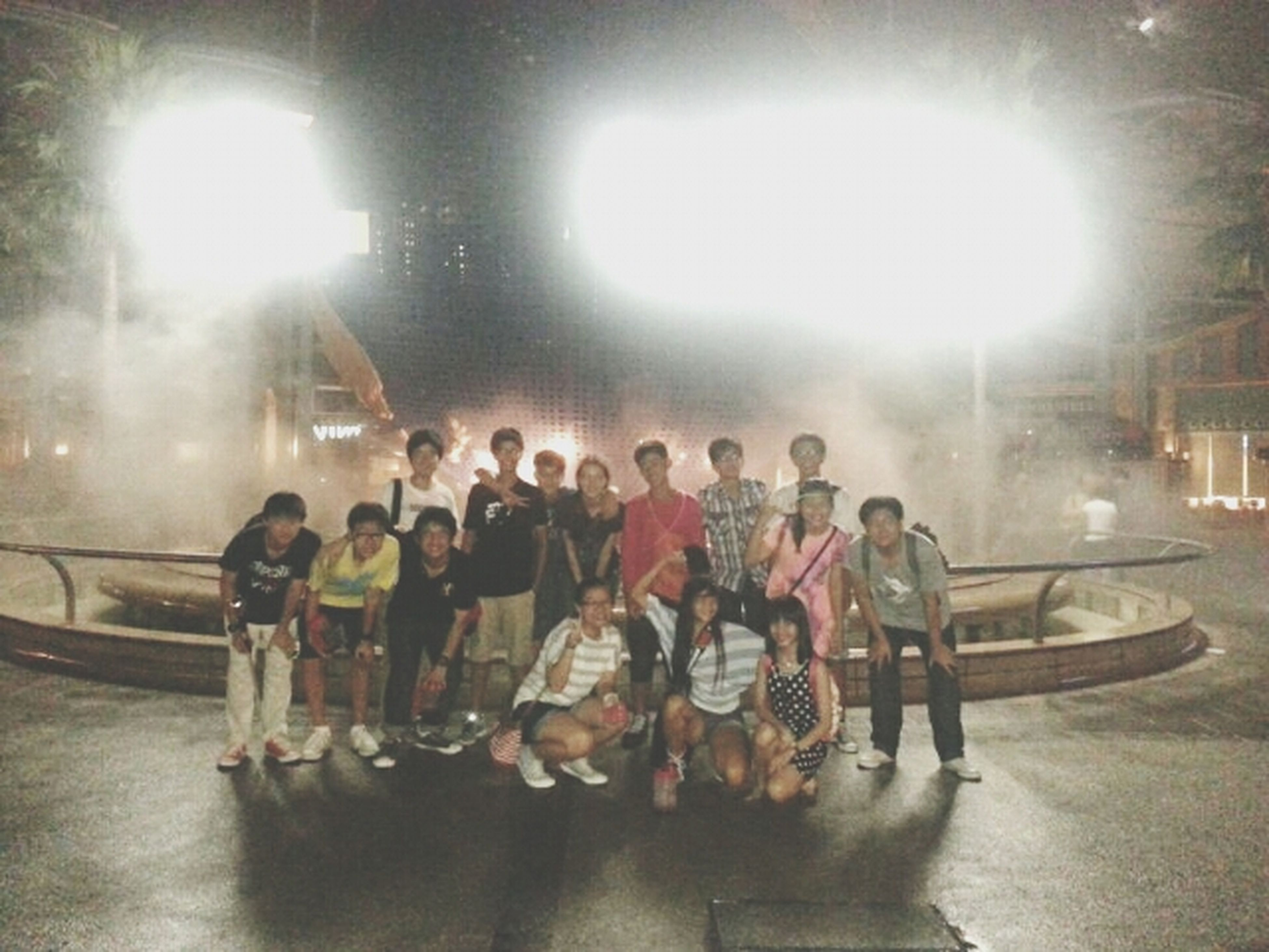 lifestyles, men, large group of people, leisure activity, person, lens flare, transportation, illuminated, built structure, sunbeam, indoors, architecture, sun, sunlight, medium group of people, mode of transport, city life, lighting equipment, full length