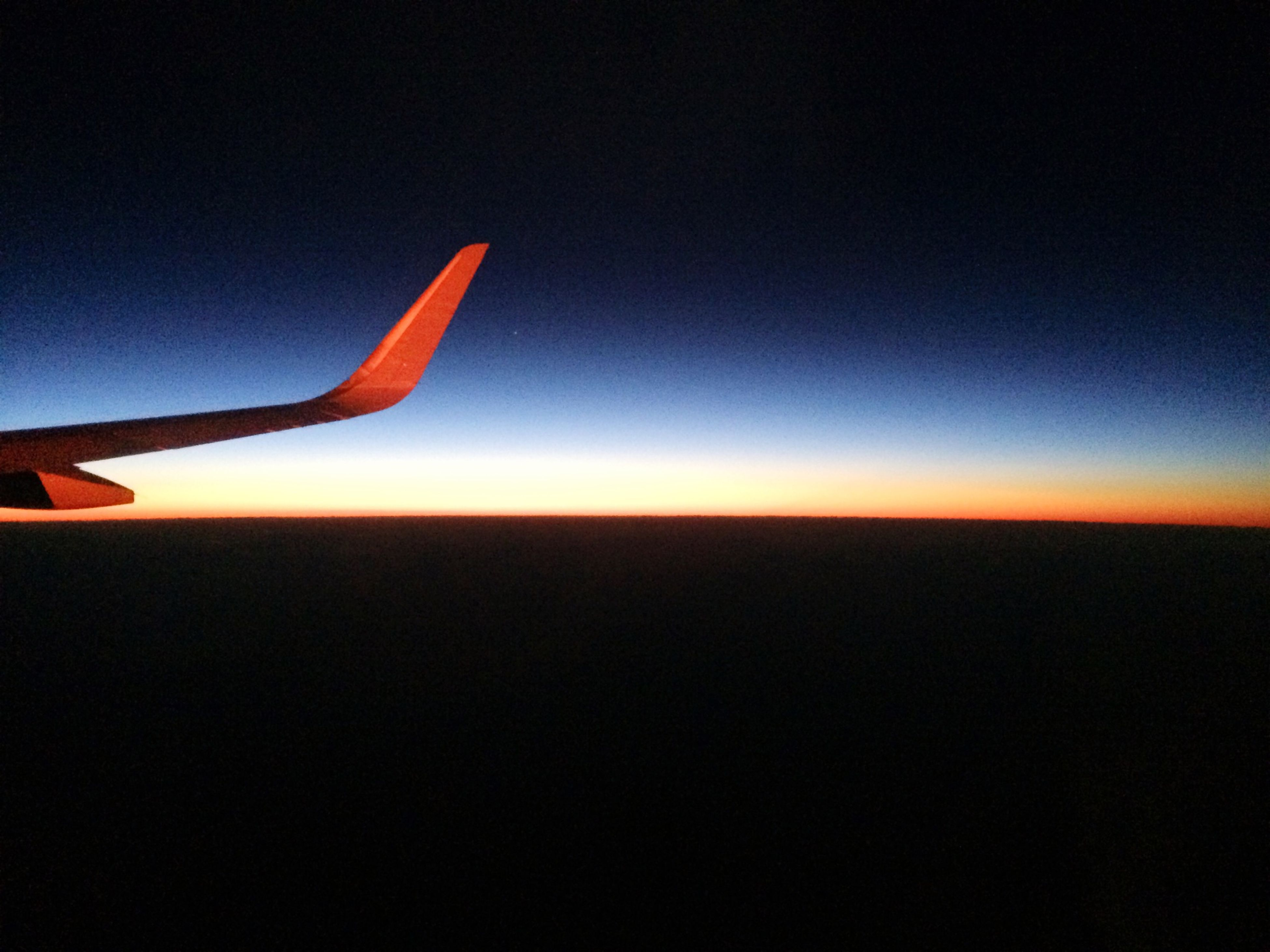 flying, airplane, copy space, sunset, air vehicle, clear sky, part of, transportation, mid-air, aircraft wing, sky, scenics, cropped, silhouette, beauty in nature, nature, orange color, blue, travel, dusk