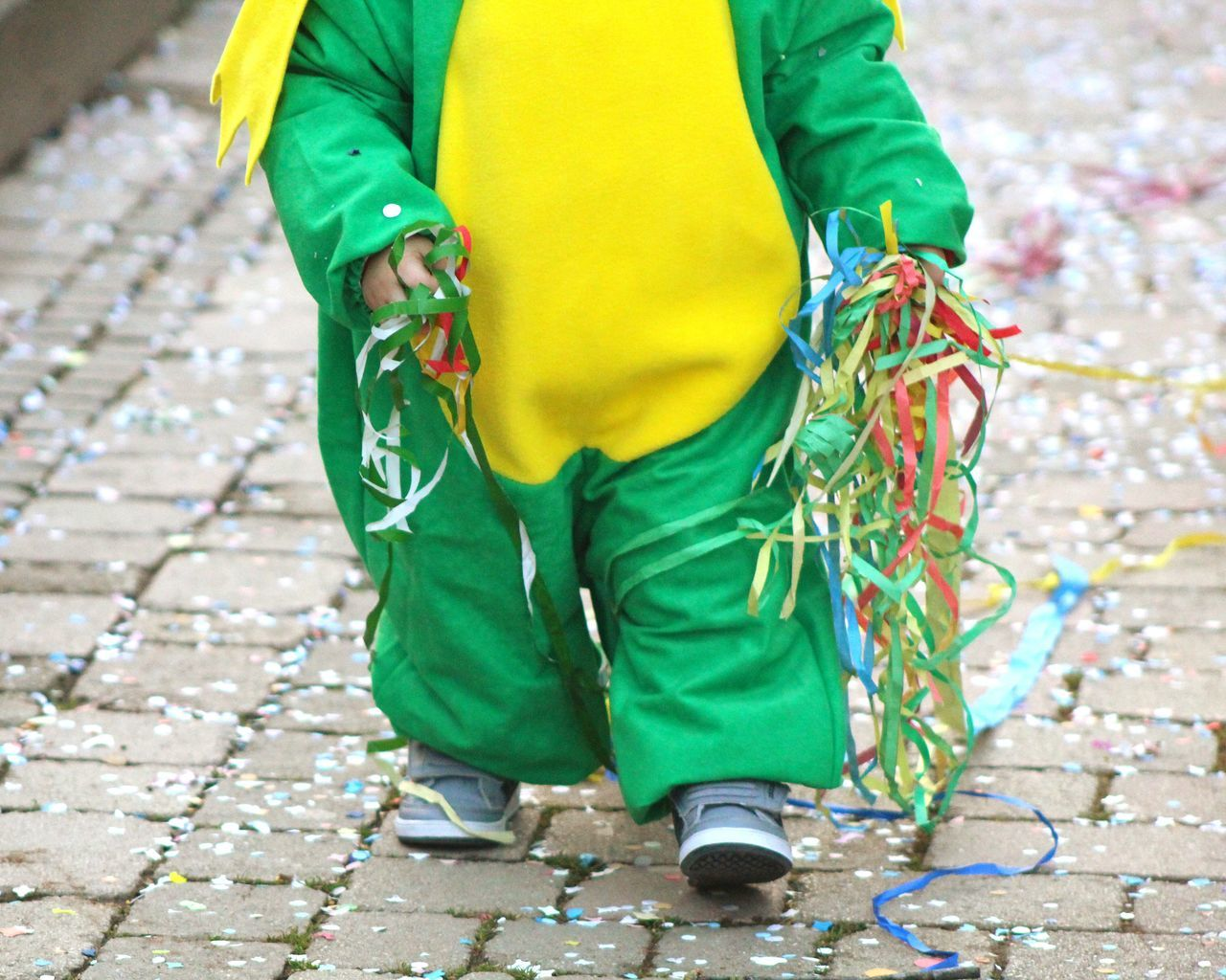 Carnival Crowds And Details Green Color Reflective Clothing Low Section Human Body Part Children Photography Childhood Children's Portraits Carnival Spirit Carnival Time Carnival Parade Day Outdoors Multi Colored Carnival Mask Carnival Party Carnival - Celebration Event Children Playing