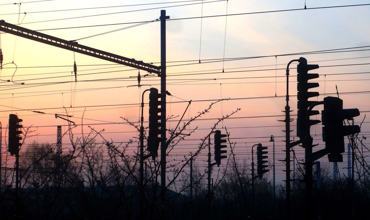 Beauty In Nature Cable Cloud - Sky Connection Day Electricity  Electricity Pylon Nature No People Outdoors Power Line  Power Supply Railroad Railroad Station Silhouette Sky Sunset