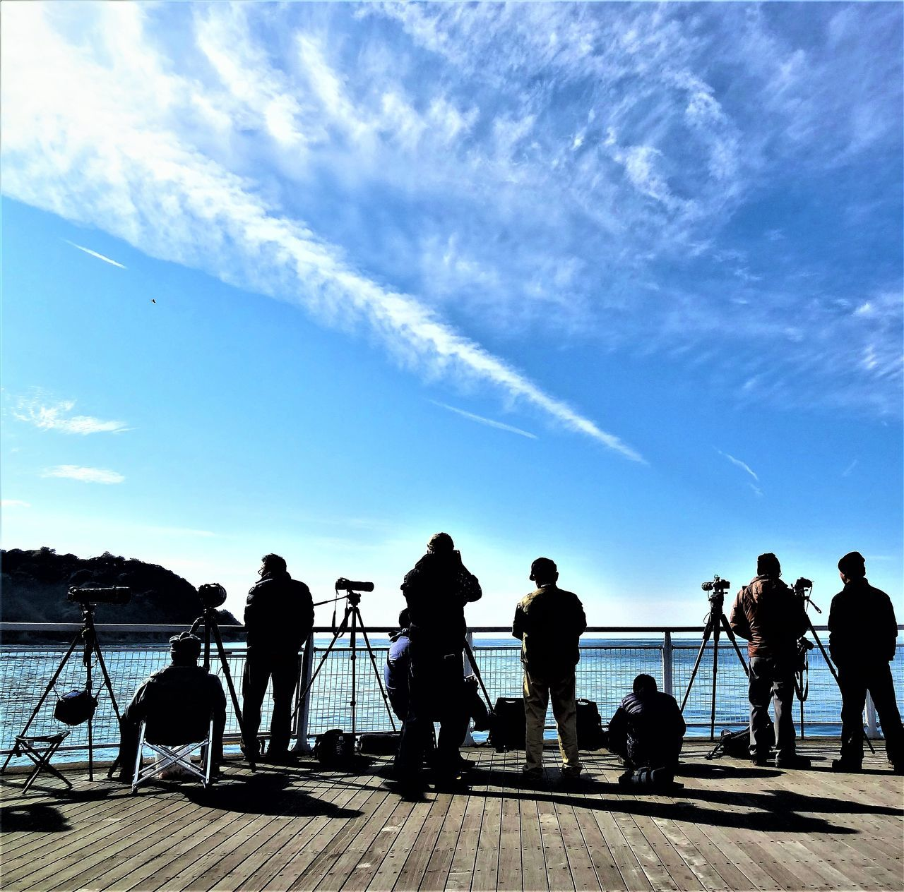 Photographer looking for birds to shoot Adult Adults Only Beauty In Nature Boat Deck Camearaphotography Camera Capture The Moment Cloud - Sky Clouds And Sky Day Men Nature Outdoors People Photograph Photographer Photographer In The Shot Photography Themes Real People Scenics Sea Sky Standing Water Women