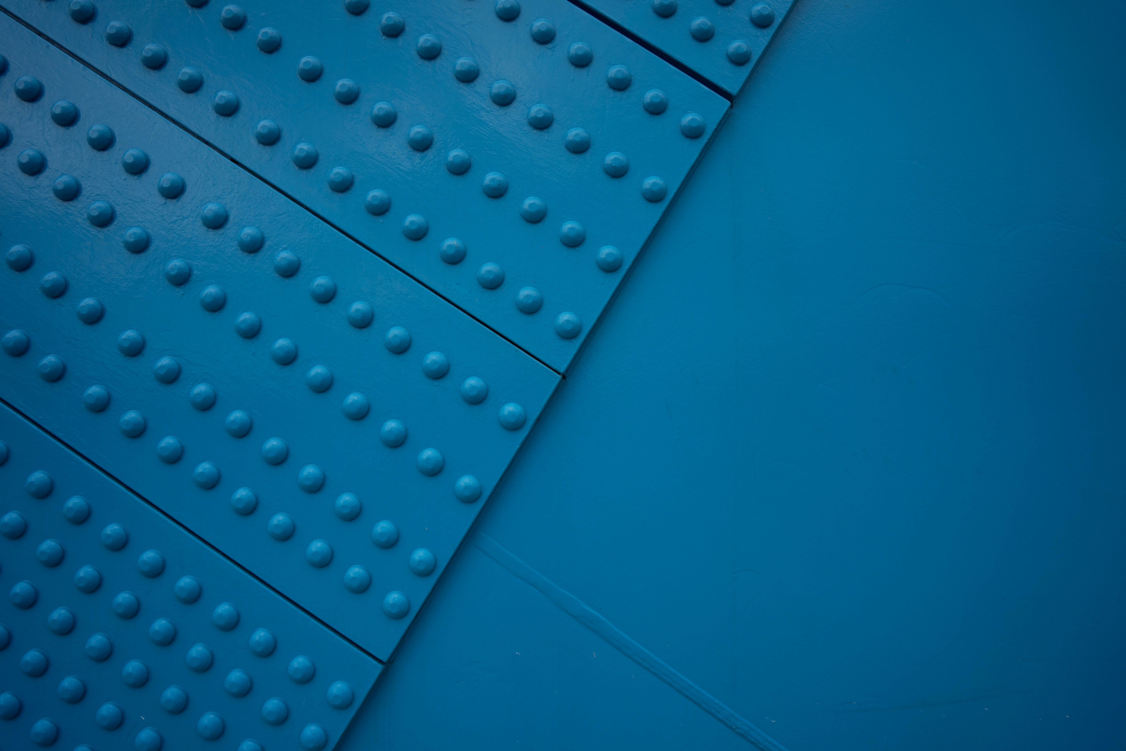 low angle view, blue, metal, modern, geometric shape, surface level, blue background, repetition, upward view, studio shot, man made object, curve