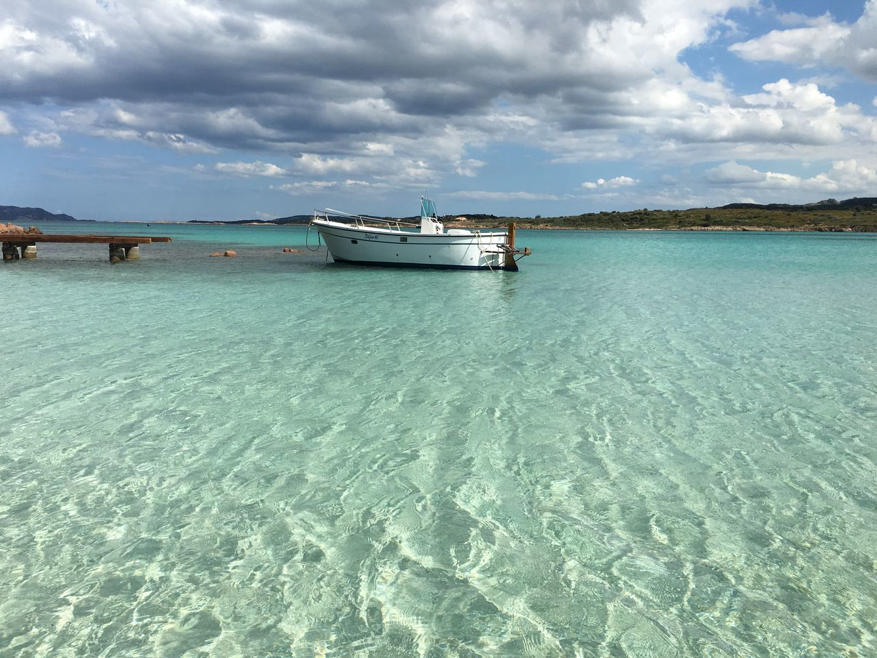 olbia Beach Beauty In Nature Cloud - Sky Cloudy Sky Crystal Clear Waters Day Island Island Living Islandlife Mode Of Transport Nature Nautical Vessel No People Outdoors Reflection Sand Scenics Sea Sky Tranquil Scene Tranquility Transportation Water