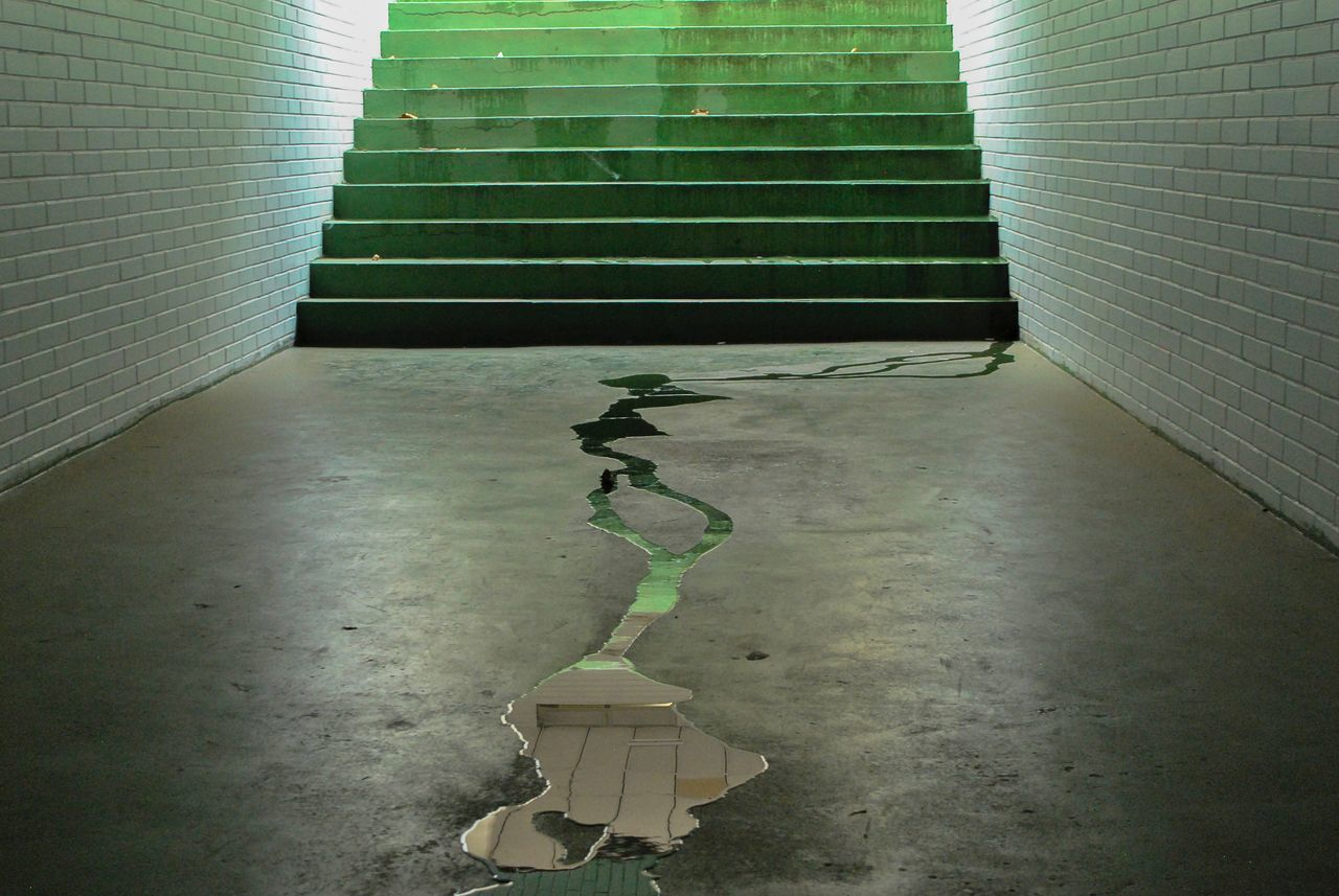 Water Spill In Subway Against Steps