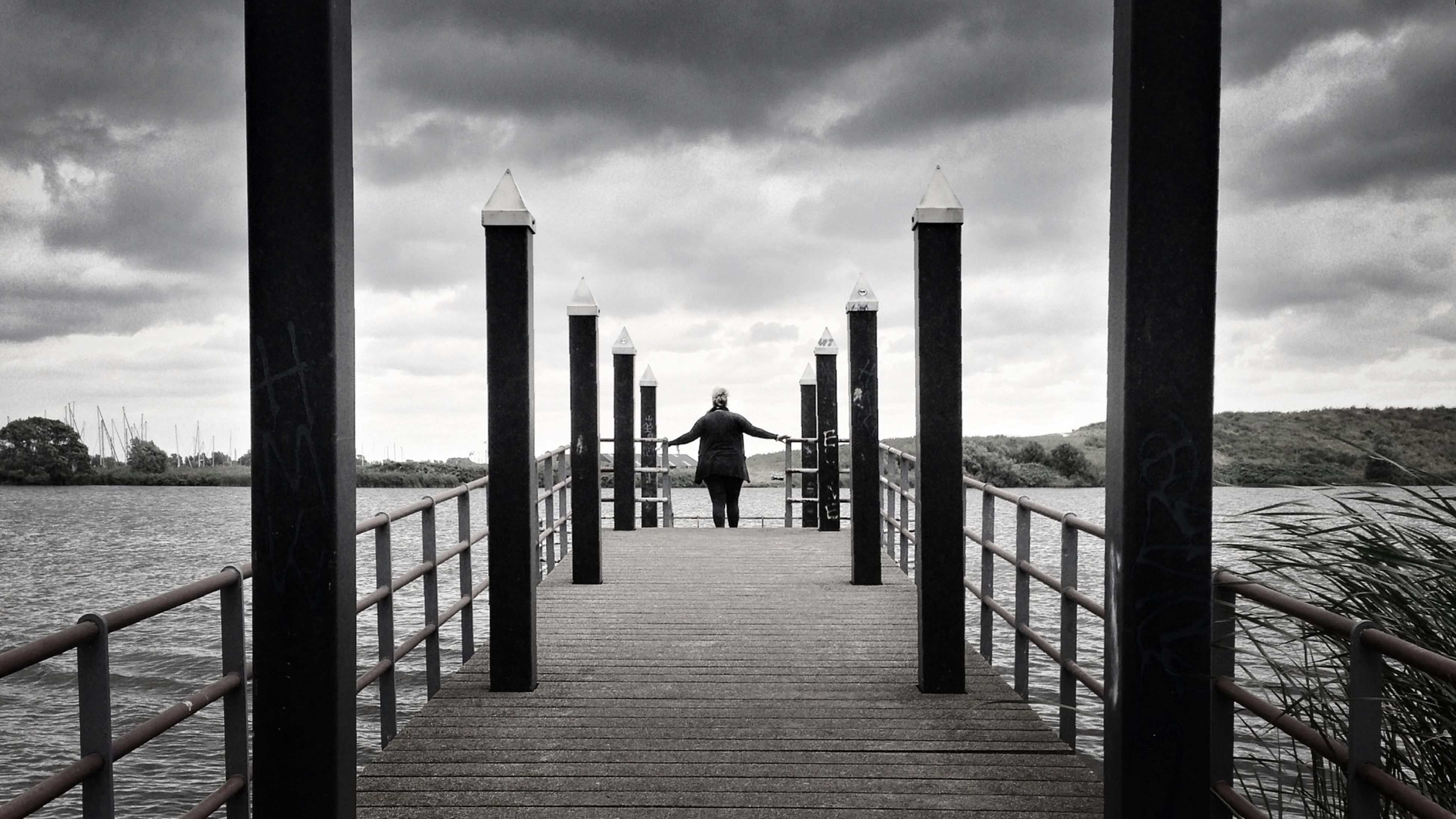 sky, railing, cloud - sky, built structure, rear view, the way forward, men, architecture, sea, water, pier, cloud, lifestyles, walking, full length, cloudy, leisure activity, person