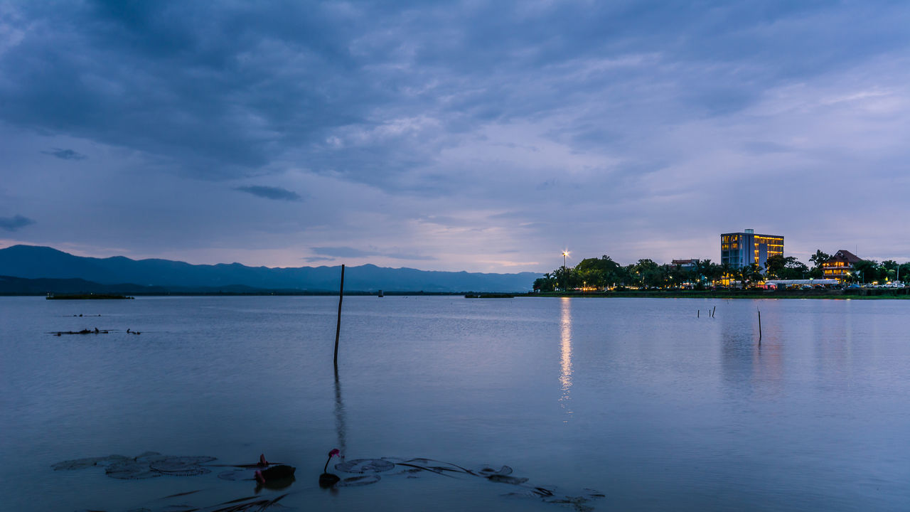 PHAYAO, THAILAND - JULY 19, 2016: The bamboo bridge, The bamboo bridge of Wat Ti Lok Aram temple in kwan phayao off freshwater lake of Thailand. Day is the important Buddhist. ASIA Bamboo Bridge Beauty In Nature Buddhist Calm Cloud Cloud - Sky Cloudy Idyllic Important Kwan Phayao Lake Mountain Mountain Range Nature Outdoors Reflection Scenics Sky Temple Thailand Tranquil Scene Tranquility Wat Ti Lok Aram Water
