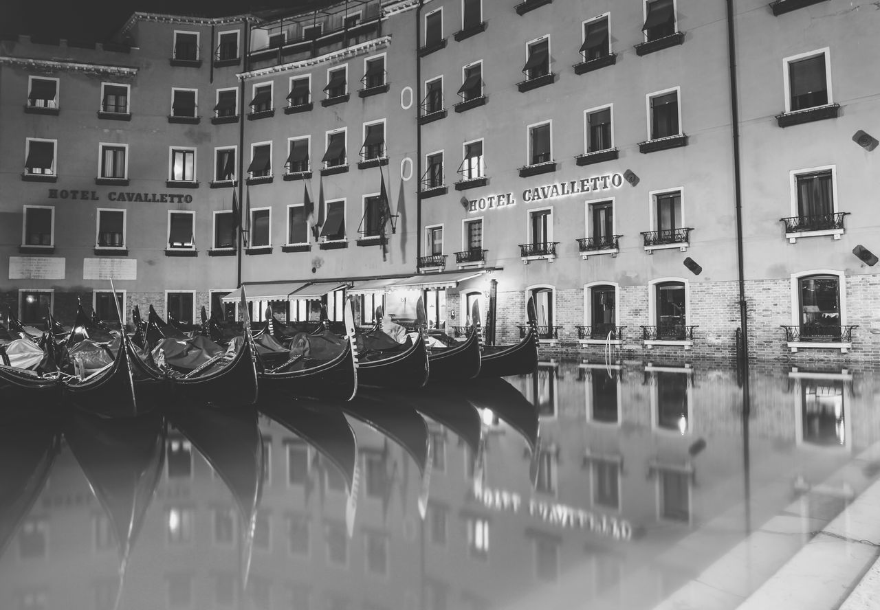 building exterior, architecture, built structure, canal, in a row, reflection, residential building, window, moored, waterfront, no people, travel destinations, city, outdoors, water, day, nautical vessel, gondola - traditional boat