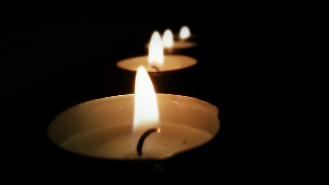 Tea Light Candles In Darkroom