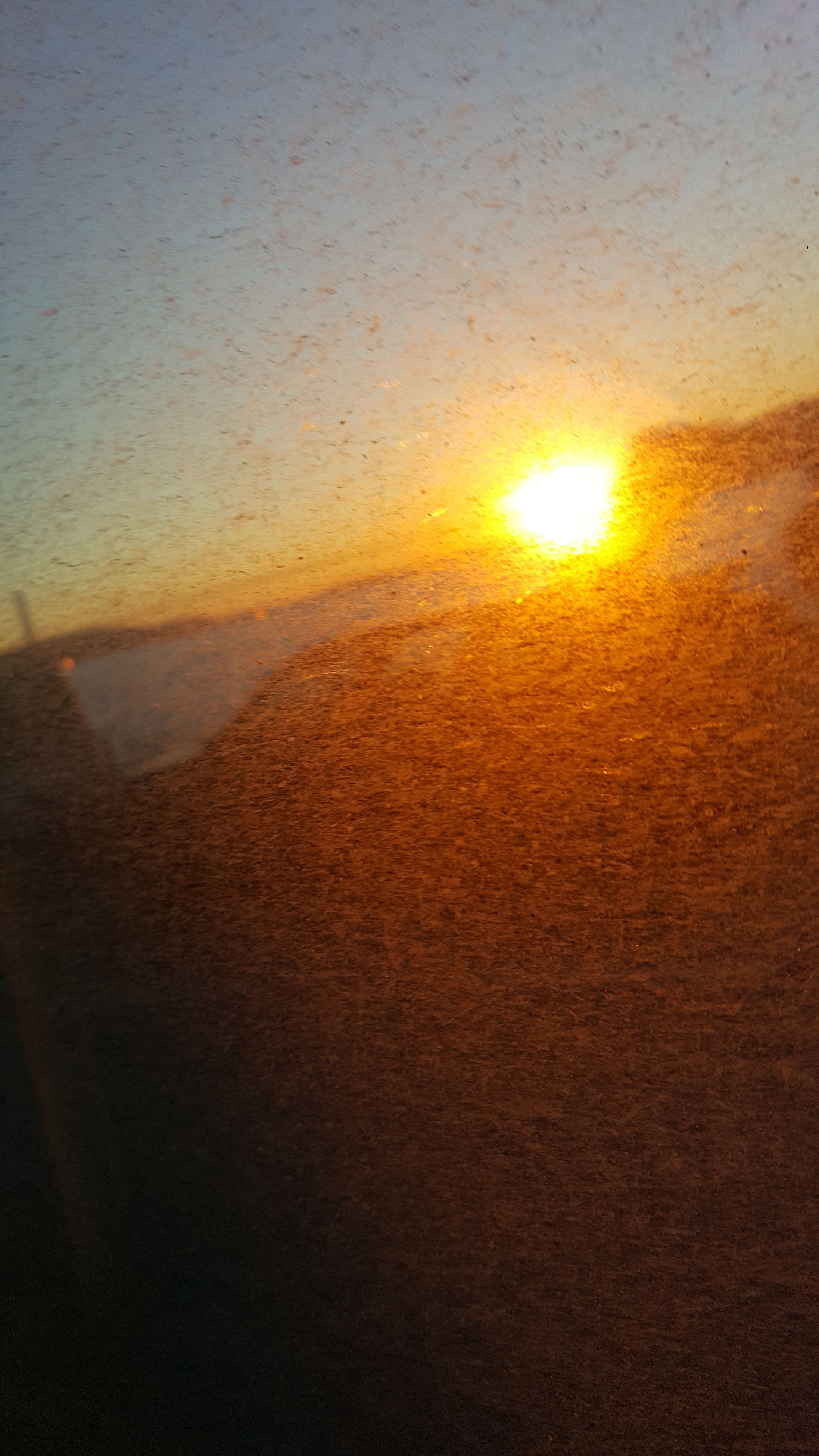 sunset, nature, sun, beauty in nature, sunlight, no people, scenics, sky, outdoors, water, sand, backgrounds, close-up, day