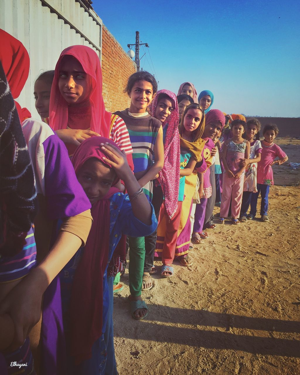 real people, outdoors, large group of people, multi colored, togetherness, day, young women, smiling, lifestyles, young adult, portrait, sky, holi, friendship, people