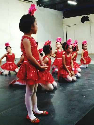 Pretty Little Girls in Red Dress Dancing Chinese Dance. Chinese Students Chinese School Chinese Culture @ China Town Koronadal City Philippines