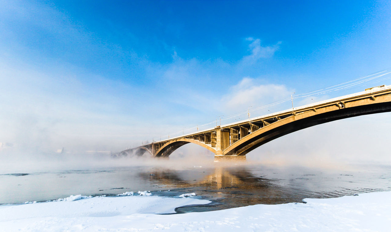 Bridge to Nowhere Architecture Blue Bridge Bridge - Man Made Structure Built Structure Connection Engineering No People Outdoors River Russia Siberia Sky The Architect - 2016 EyeEm Awards The Great Outdoors - 2016 EyeEm Awards Travel Destinations Water Yenisei River