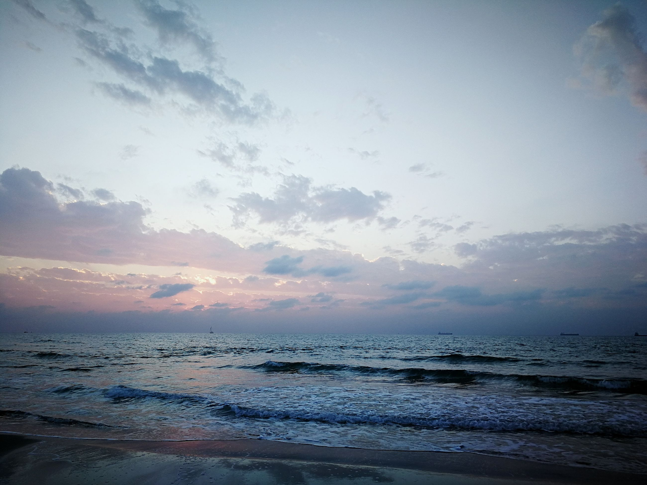 sea, beauty in nature, water, scenics, nature, tranquil scene, sunset, sky, tranquility, horizon over water, beach, no people, outdoors, day