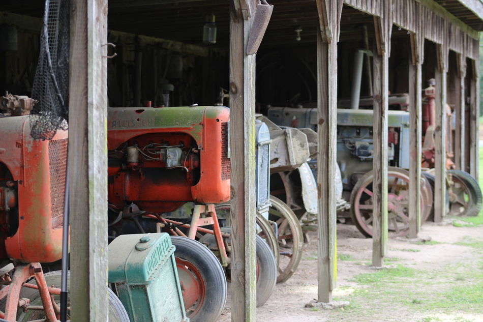 Tractors at Laurel Valley plantation in Thibodaux Louisiana Day Deterioration Farm Equipment No People Old Farm Old Tractors Outdoors Parked Run-down Stationary Tractors Transportation