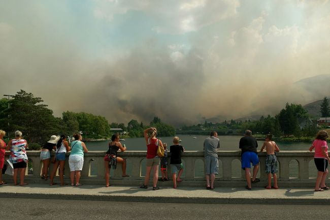 Untold Stories in Chelan. Tourists and locals unite during a Firestorm to support their firefighters. The Photojournalist - 2016 EyeEm AwardsThe Tourist Travel Stories Traveling Devastation The Changing City Wildfire Fire Community Disaster Urban Lifestyle Capture The Moment Smoke Summer Views RePicture Growth Original Experiences People Together